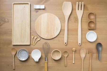 various kitchen utensils on wooden table background