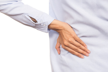 suffers: woman suffers from back pain