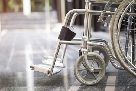 invalidity: Empty wheelchair parked in hospital Stock Photo