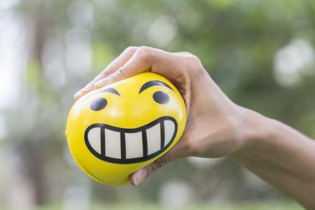 stress ball: Hands of a woman holding a stress ball