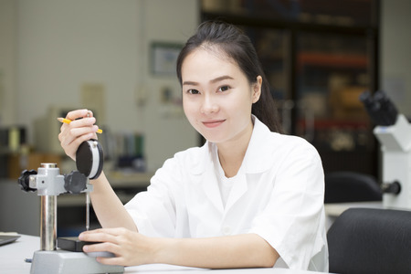 thickness: young engineer using vernier height gauge