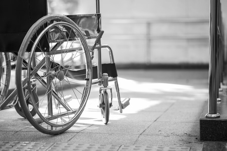 disablement: Empty wheelchair parked in hospital Stock Photo