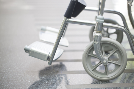 mobility nursing: Empty wheelchair parked in hospital Stock Photo