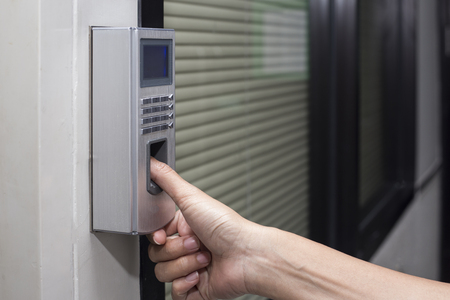 access control: fingerprint and password lock in a office building Stock Photo