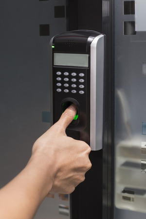 lock  futuristic: fingerprint and password lock in a office building Stock Photo