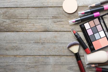 feminine background: Set of colorful cosmetics on table background Stock Photo