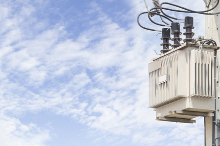 amp tower: electric transformer with blue sky