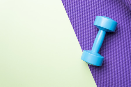 four classes: yoga mat and dumbbell Stock Photo