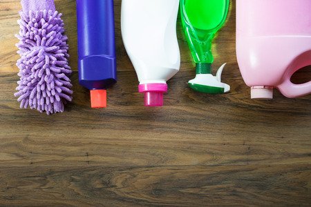 office cleanup: House cleaning product on wood table Stock Photo
