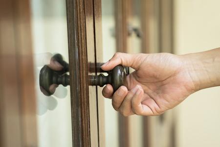 door handle: hand hold handle of wood door