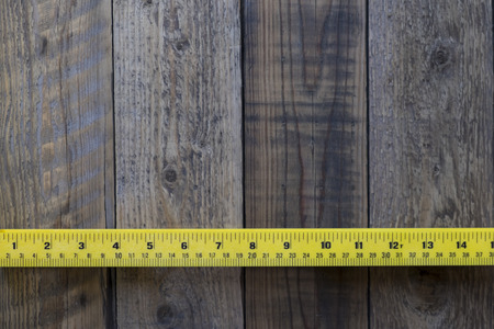 empirical: ruler on wood background