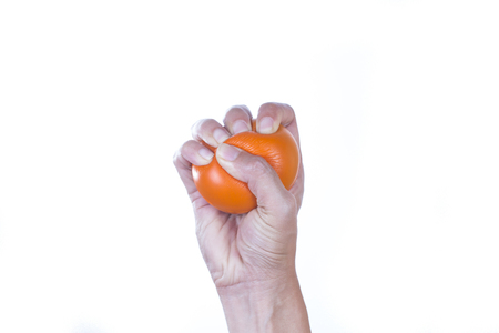 stress ball: Hands of a woman squeezing a stress ball