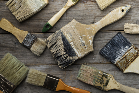 redecorating: old brushes on the wood table Stock Photo