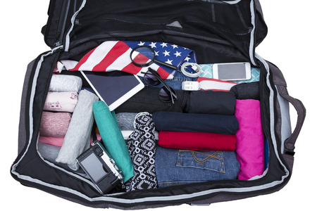 open suitcase: Open suitcase with clothing on white background