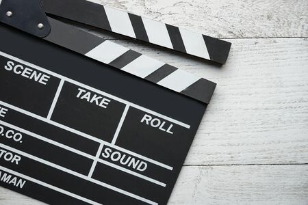clapper: movie clapper on wood table Stock Photo