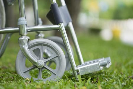 Empty wheelchair parked in park