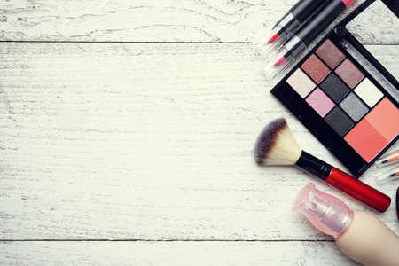 feminine background: Set of colorful cosmetics on white table background