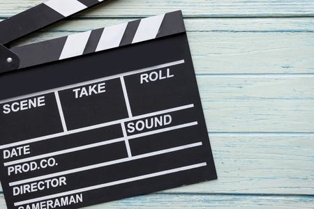 movie clapper: movie clapper on wood table Stock Photo