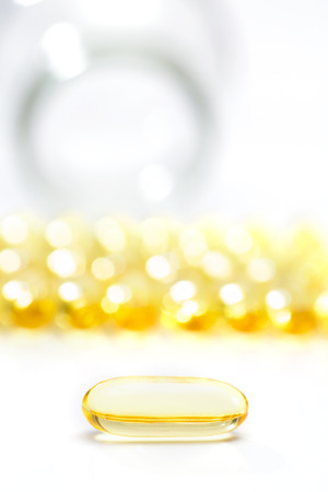fish oil set in a row on white background