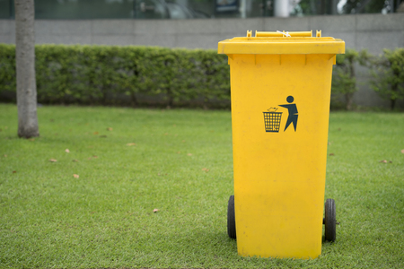 close up of yellow bins in public park Stock Photo