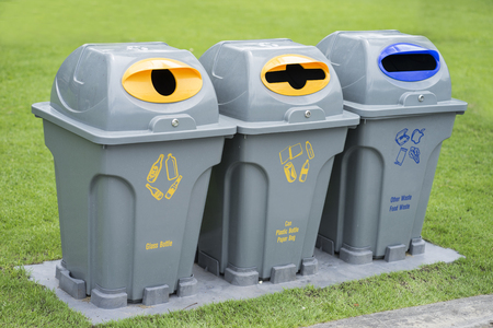 public waste: Segregated waste bins for garbage in public park Stock Photo