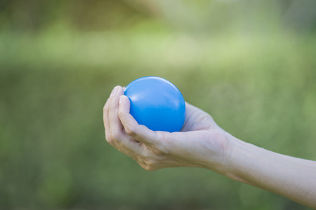 stress ball: Hand of a woman squeezing a stress ball