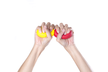 squeezing: Hands of a woman squeezing a stress balls Stock Photo