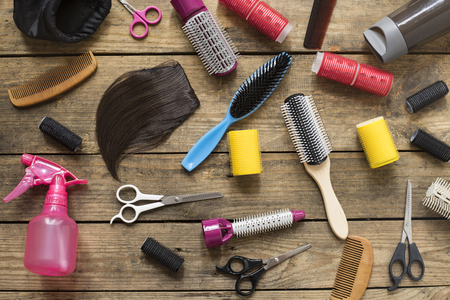 hairdresser: hairdresser tools on wood table
