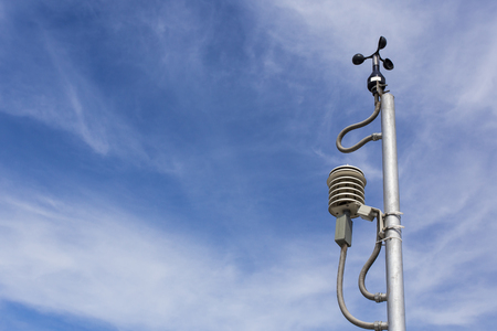 Anemometer in a farm with blue sky Stock Photo