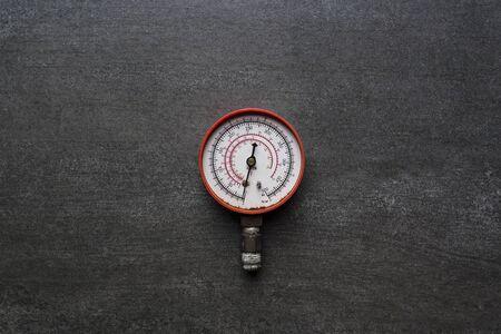 antique fire truck: old pressure gauge on black background Stock Photo