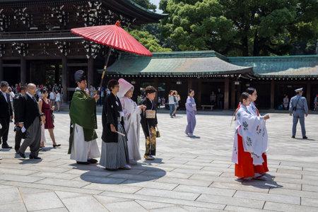 harajuku: HARAJUKU,TOKYO -JULY 2015: Celebration of a typical wedding ceremony on July 11,2015 in Meiji Jingu Shrine Harajuku Tokyo, Japan