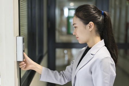 Woman scaning finger print for enter security system Standard-Bild