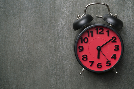 Retro alarm clock on black background Stock Photo