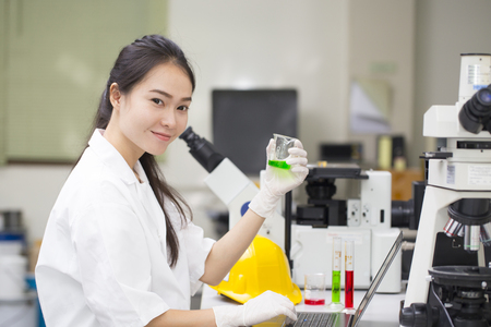 Scientist doing chemical test in laboratory