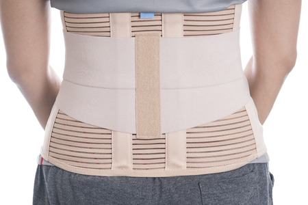 posture correction: close up back support for muscle back on white background