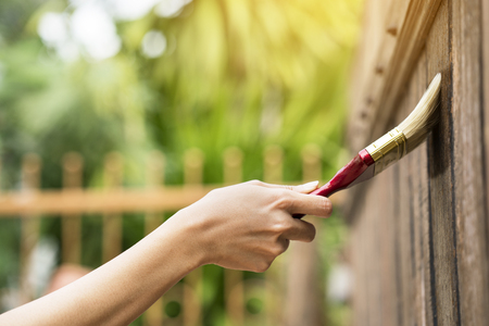 Applying protective varnish on a wooden texture Stock Photo