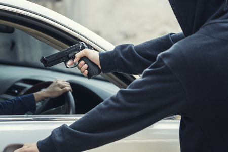 law breaker: side view of car thief in action Stock Photo