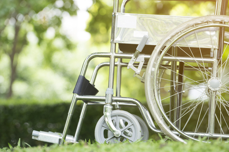 Empty wheelchair parked in hospital Stock Photo