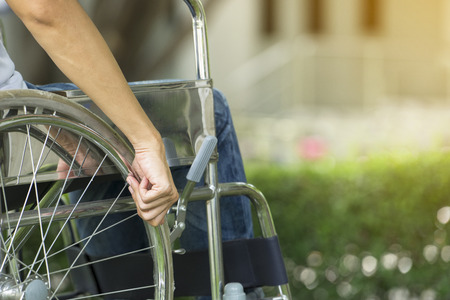 woman using a wheelchair in a park, medicine and healthy concept