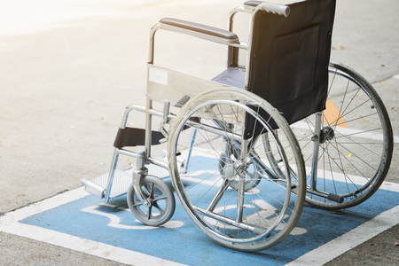 physical impairment: Pavement handicap symbol and wheelchair in the hospital, medicine and healthy concept