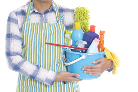 woman with cleaning equipment ready to clean house on white background Stock Photo