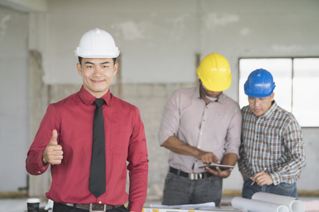 Asian engineers were consulted together and plan in construction site Stock Photo