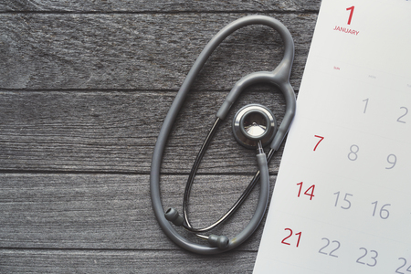Top view of stethoscope and calendar on the table background, schedule to check up healthy concept Stock Photo