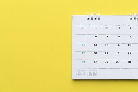 close up of calendar on yellow background, planning for business meeting or travel planning concept 版權商用圖片