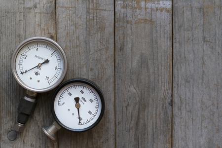 pressure gauge on wood background