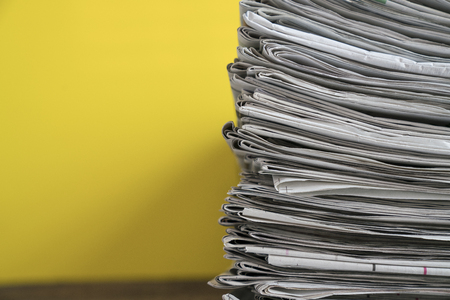 close up newspapers folded and stacked background on the table Stock Photo