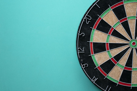 Target dart board on the green background, center point, head to target marketing and business concept
