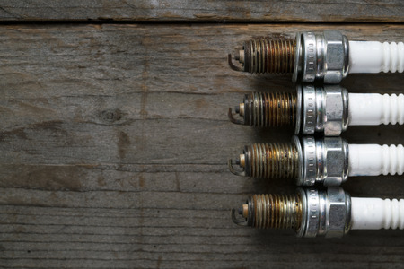 Old spark plugs on the wooden table