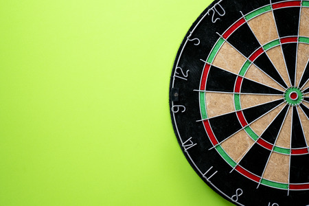 Target dart board on the green background, center point, head to target marketing and business success concept