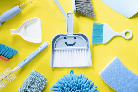 House cleaning product on yellow table background